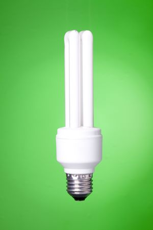 Energy saving lamp on green gradient background Stock Photo - 6417469