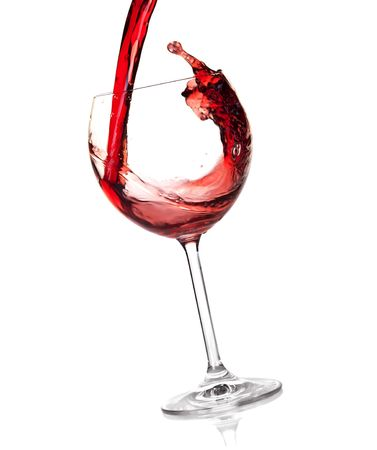Wine collection - Red wine is poured into a glass. Isolated on white background photo