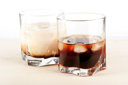 Black russian and white russian cocktails. Ingredients for black: 5 oz vodka, 2 oz kahlua. Ingredients for white: 2 oz vodka, 1 oz kahlua, 1 oz milk photo