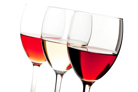 Wine collection - Rose, White and Red wine. Small DOF. Isolated on white background photo