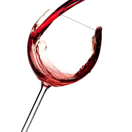 Wine collection - Red wine is poured into a glass. Closeup. Isolated on white background photo