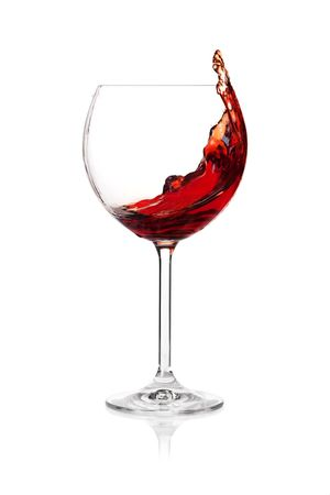 glass of red wine: Wine collection - Splashing red wine in a glass. Isolated on white background