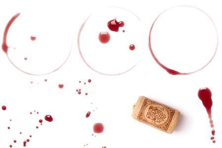 Wine collection - stains, spots and cork. On white background photo