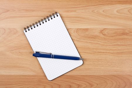 Blank notepad with pen on wood table Stock Photo - 6737171
