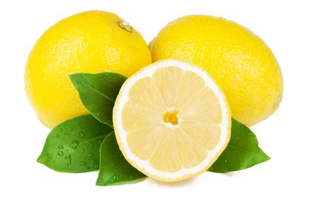 Fresh juicy lemons with green leafs. Isolated on white background photo