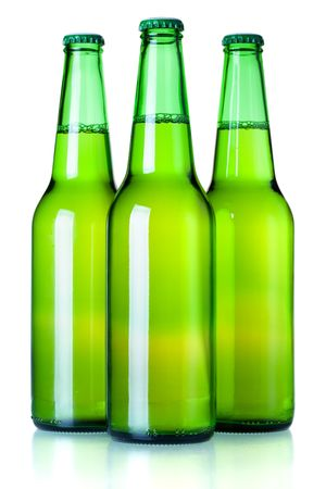 Beer collection - Three green beer bottles. Isolated on white background photo