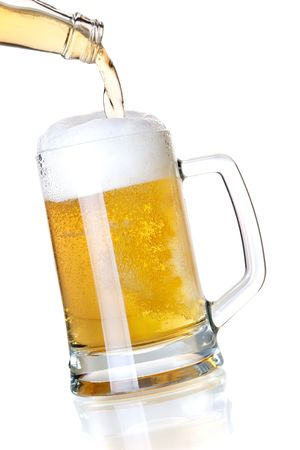 Beer collection - Beer is pouring into a glass from bottle photo