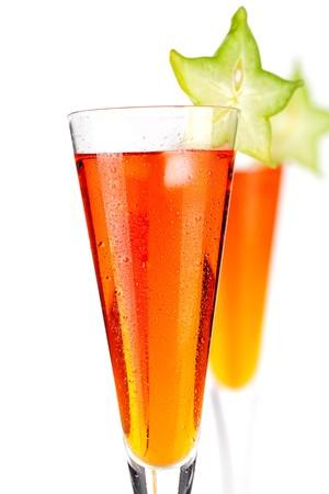Orange alcohol cocktail with carambola isolated on white background photo