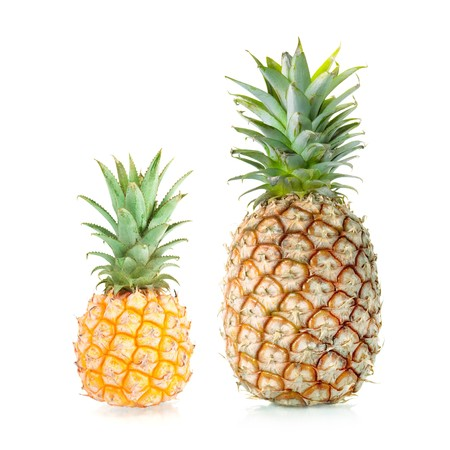 Mini and XL Pineapple. Isolated on white background photo