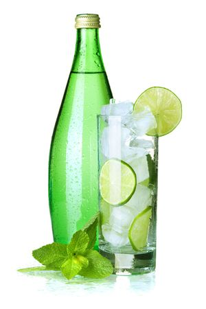 Glass of water with lime, ice, mint and bottle with mineral water. Isolated on white background.