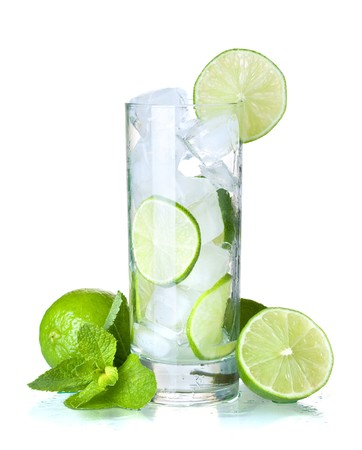 Glass of water with lime, ice and mint. Isolated on white background. photo
