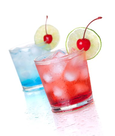 Two cocktails with lime slice and maraschino. Isolated on white background photo