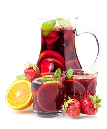 Cocktail collection - Refreshing fruit sangria in jug and two glasses. Isolated on white photo