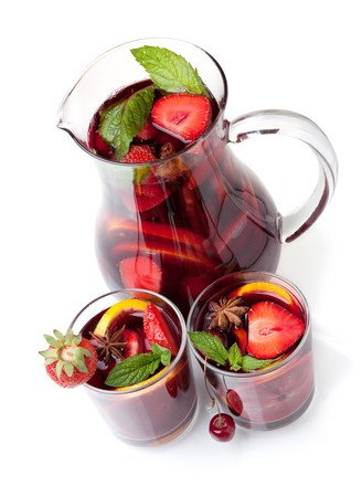 Cocktail collection - Refreshing fruit sangria in jug and two glasses. Above view, isolated on white photo