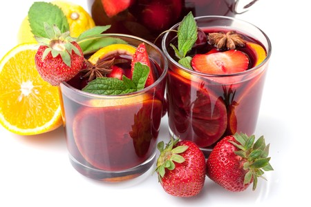 Cocktail collection - Two glasses of fresh fruit sangria. Closeup, isolated on white photo