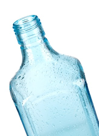 bottleneck: Blue empty bottle with water drops. Closeup, isolated on white background Stock Photo