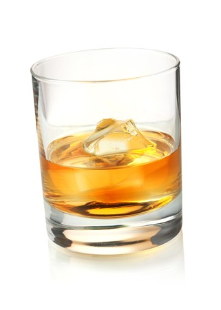 brandy: Glass of whiskey with ice. Isolated on white background