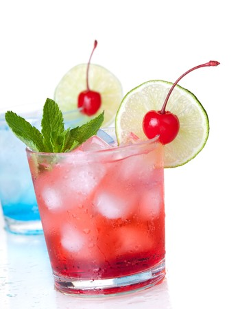maraschino: Two cocktails with lime slice and maraschino. Isolated on white background