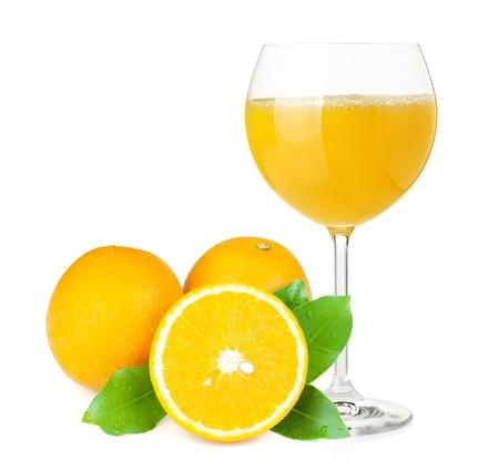 Orange juice in wine glass and oranges. Isolated on white background photo