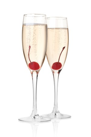 maraschino: Two champagne with maraschino in glass. Isolated on white background Stock Photo