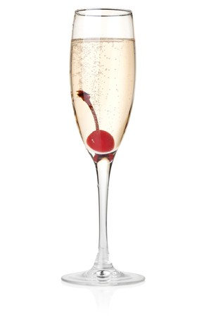 Champagne with maraschino in glass. Isolated on white background photo