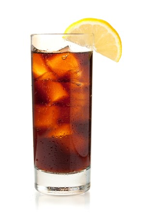highball: Cola in highball glass with lemon slice. Isolated on white background