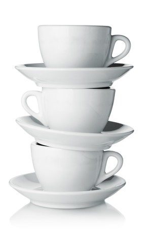 cup saucer: White coffee cups with saucers. Isolated on white