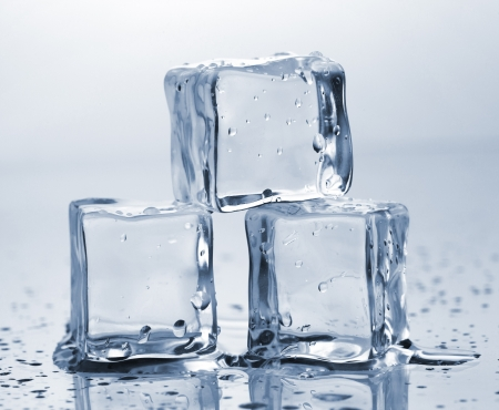 Three ice cubes on glass table photo