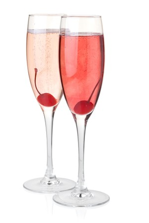Red and rose champagne with maraschino. Isolated on white photo