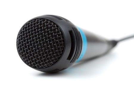 Microphone with cable. Small DOF, isolated on white photo