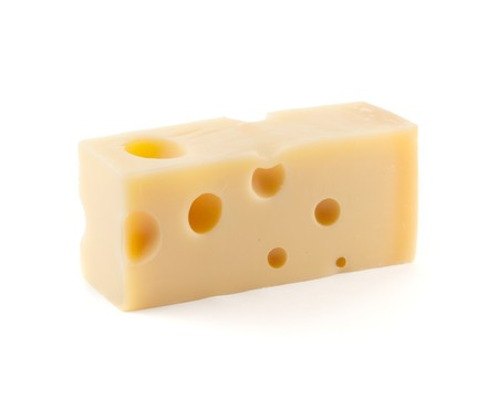 Piece of cheese with holes. Isolated on white Stock Photo - 7875882
