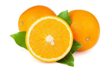 orange cut: Fresh juicy oranges with green leafs. Isolated on white background