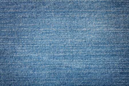 worn jeans: Blue jeans texture