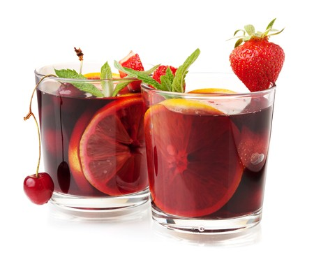 gin: Cocktail collection - Two glasses of fresh fruit sangria. Isolated on white