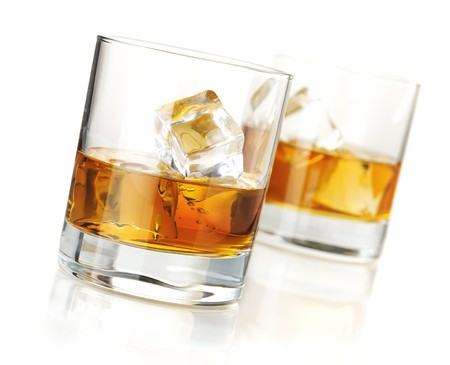 brandy: Two whiskey glasses. Isolated on white with reflection