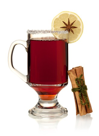mulled wine: Hot mulled wine with lemon, anise and cinnamon. Isolated on white