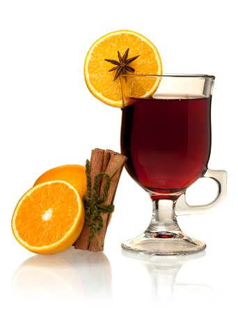 Hot mulled wine with oranges and cinnamon. Isolated on white photo