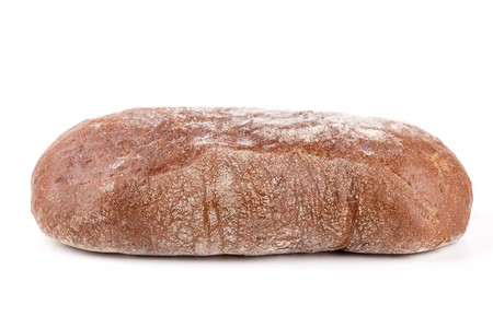 Fresh brown bread. Isolated on white background photo