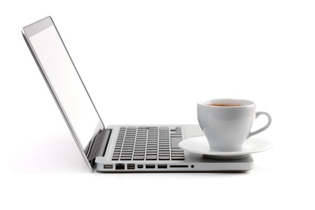 notebook computer: Cappuccino cup on laptop. Isolated on white background
