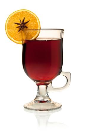 Hot mulled wine with orange slice and anise. Isolated on white