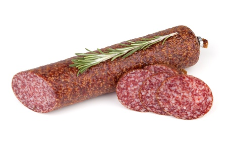 Slices italian salami sausage with rosemary. Isolated on white background photo