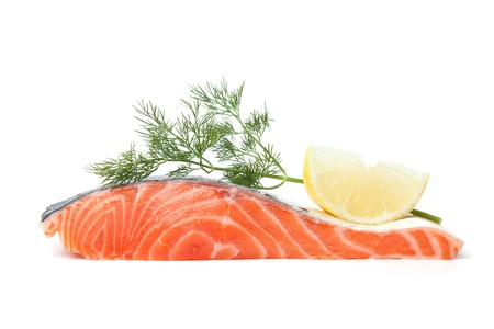 Fresh salmon steak with lemon slice and dill. Isolated on white background photo