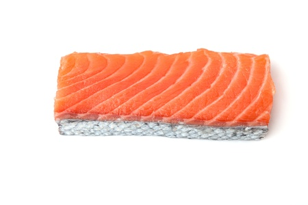 Fresh salmon piece with scale. Isolated on white photo