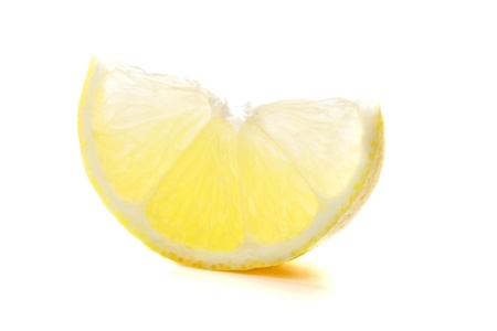 Section of ripe lemon. Isolated on white photo