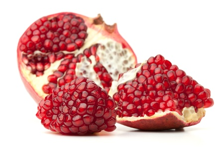 a pomegranate: Red pomegranate fruit. Isolated on white background Stock Photo
