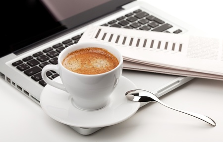 Cappuccino cup on laptop. Small DOF photo