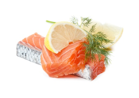 Two salmon pieces with lemon and dill. Isolated on white photo