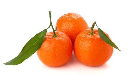Three ripe tangerines with leafs. Isolated on white photo