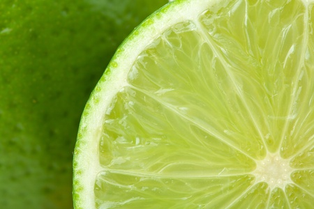 Ripe lime closeup with rind on background