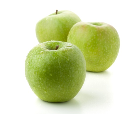 Three ripe green apples. Isolated on white photo